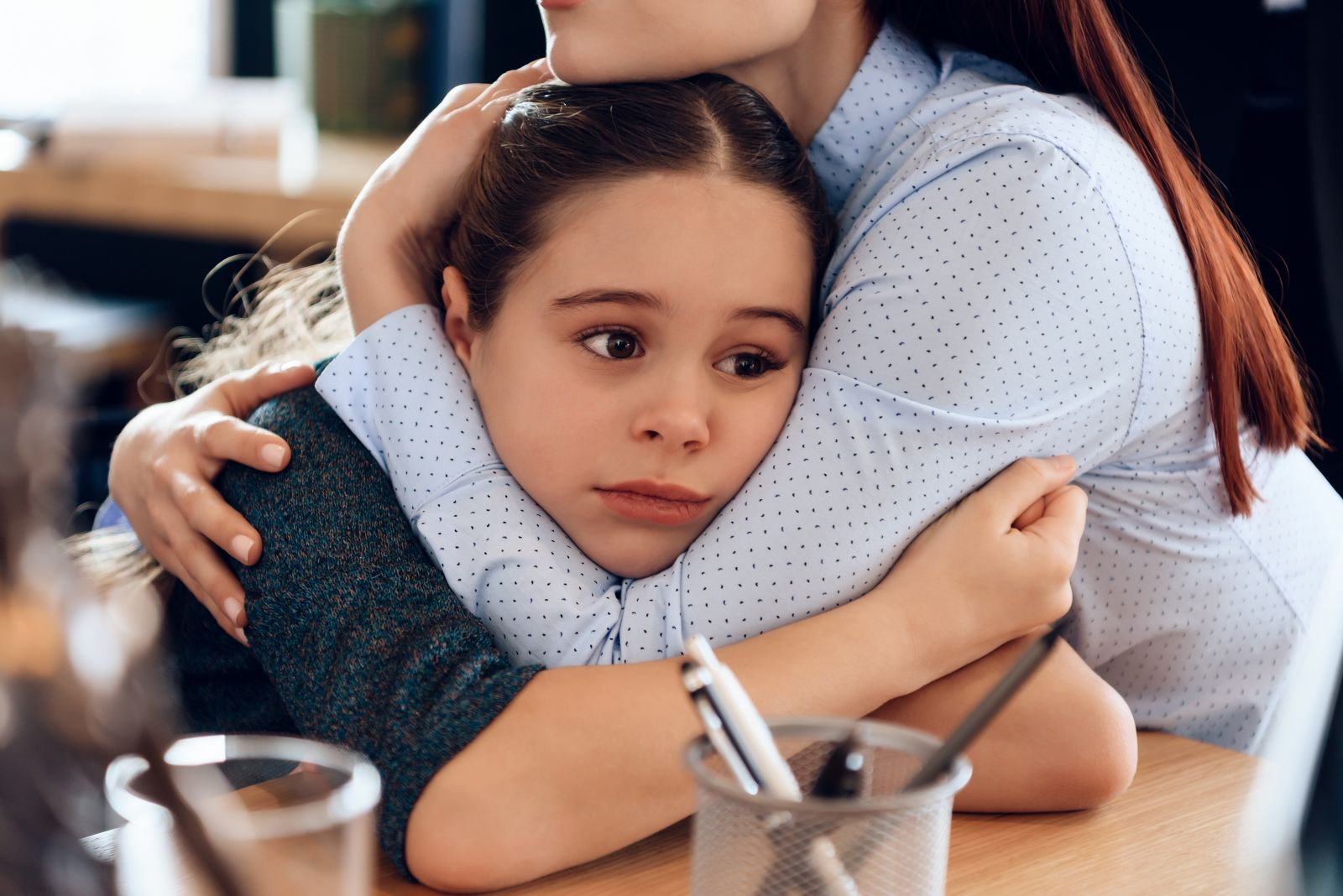 Woman Hugging Sad Scared Child banner image